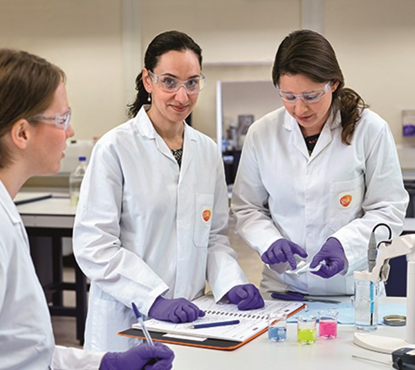 Graduates in a GSK lab